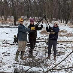Three volunteers with their loppers
